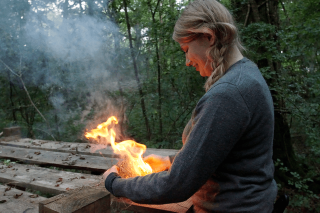 Vicky making fire using a ferro rod