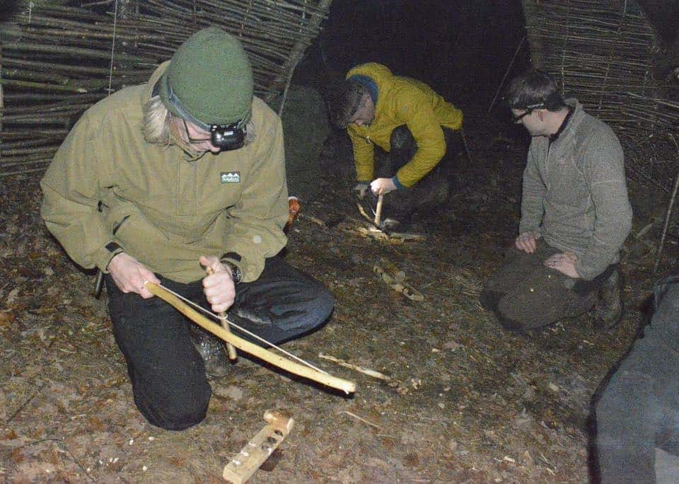 Evening bow drill session in our bushcraft round house