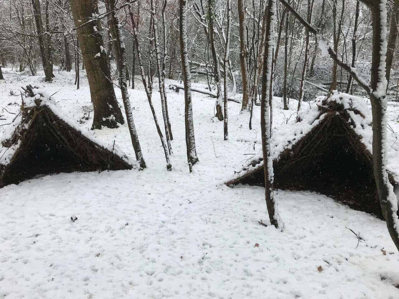 A couple of winter bushcraft shelters
